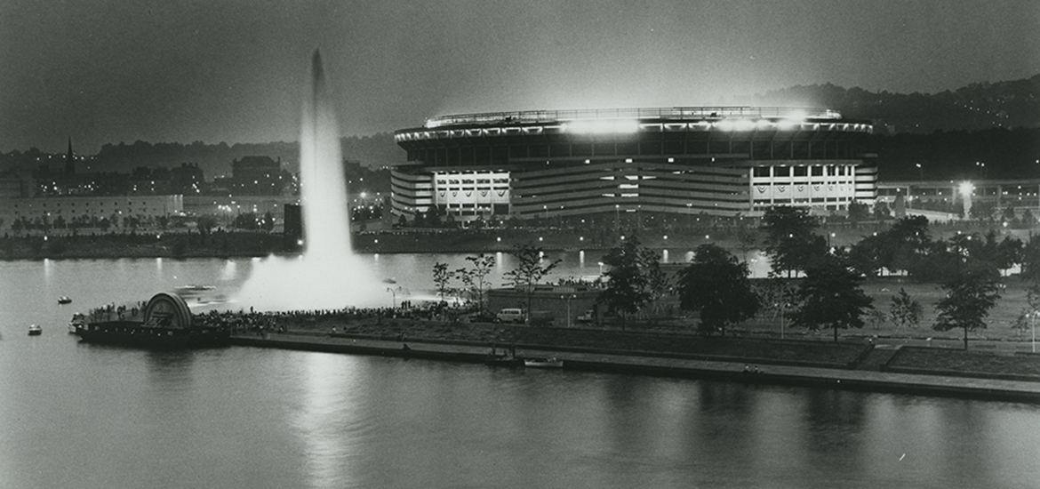 Fountain at Point State Park looking toward Three Rivers Stadium, 1974. Allegheny Conference on Community Development Photographs, 1892-1981, MSP 285, Senator John Heinz History Center.