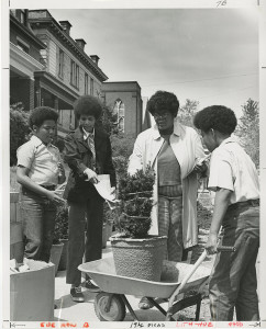 ALT:Participants and a staff member of Operation Better Block take part in a street beautification program, c. 1975. Allegheny Conference on Community Development Photographs, 1892-1981, MSP 285, Senator John Heinz History Center.