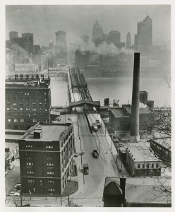 ALT:Downtown Pittsburgh before Smoke Control, c.1944. Photograph by John R. Schrader. Allegheny Conference on Community Development Photographs, 1892-1981, MSP 285, Senator John Heinz History Center.