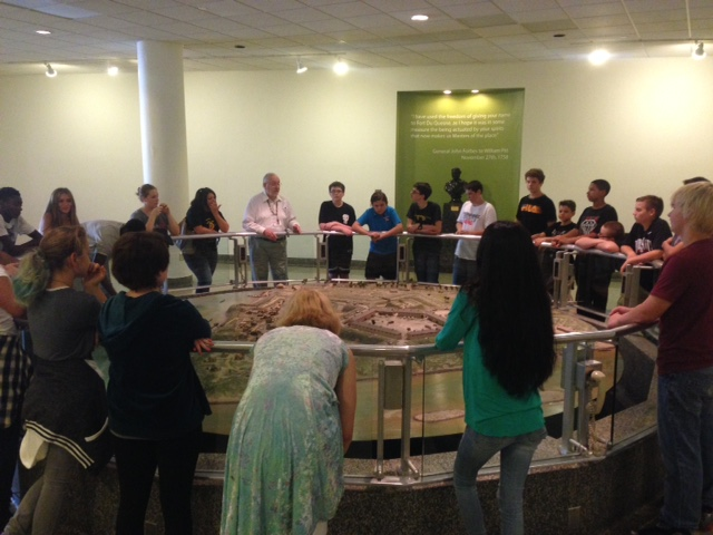 Jack Sheehan, History Center and Fort Pitt Museum docent, showing a school tour the Fort Pitt diorama.