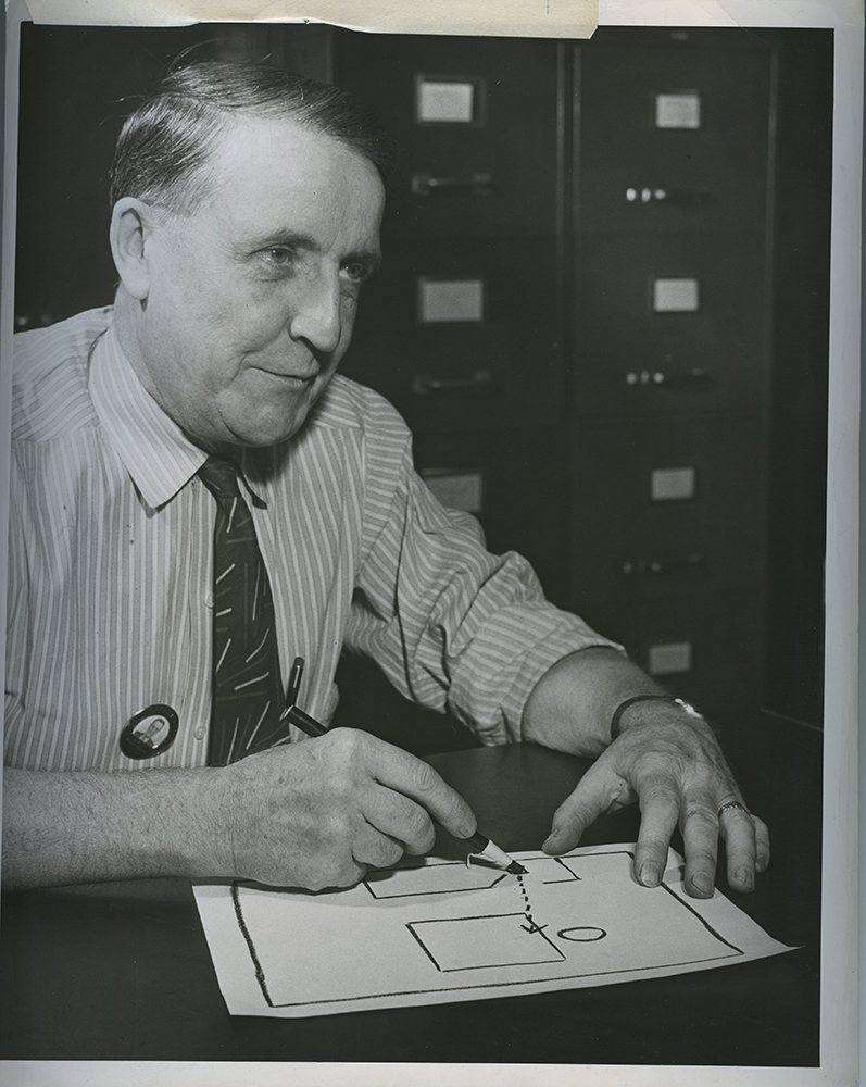 "Ed Kilchenstein with a diagram indicating how the ""Westinghouse at Work"" photograph was taken."