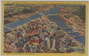 ALT:Aerial view of downtown Pittsburgh showing the Point where the Allegheny and Monongahela Rivers form the Ohio River. General Postcard Collection, GPCC, Detre Library & Archives, Senator John Heinz History Center.