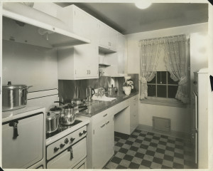 ALT:Typical kitchen in Chatham Village, view of stove with pots and pans, cabinets, and sink. | Buhl Foundation Photographs, MSP 187, Detre Library & Archives at the Senator John Heinz History Center.
