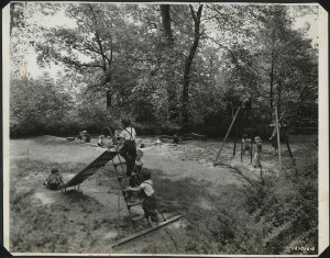 ALT:Scene in Chatham Village summer playschool with children on slide and swing set, July 1945. | Buhl Foundation Photographs, MSP 187, Detre Library & Archives at the Senator John Heinz History Center.
