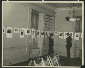 ALT:Two men viewing Chatham Village Camera Club exhibit, December 1, 1937. | Buhl Foundation Photographs, MSP 187, Detre Library & Archives at the Senator John Heinz History Center.