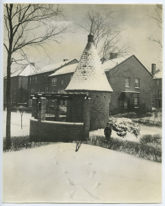 ALT:Snow scene in first unit of Chatham Village with a child next to a gazebo, January 23, 1936. | Buhl Foundation Photographs, MSP 187, Detre Library & Archives at the Senator John Heinz History Center.