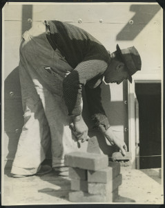 ALT:Bricklayer installing bricks in Chatham Village, October 1935. | Buhl Foundation Photographs, MSP 187, Detre Library & Archives at the Senator John Heinz History Center.