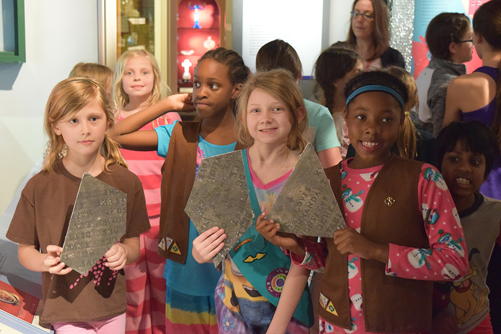 Girl Scouts with the Celeron plate pieces they discovered in the museum.