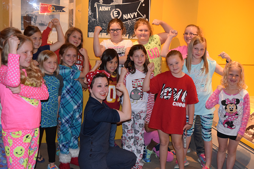 Girl Scouts with Rosie the Riveter.