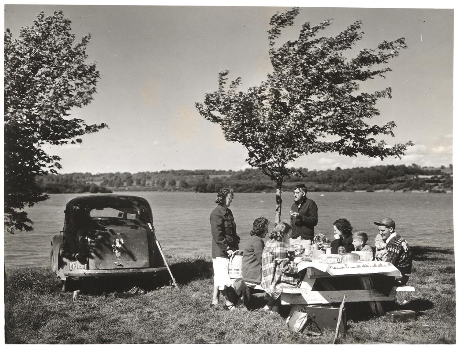 Picnickers enjoy a chilly feast by Pymatuning Reservoir Lake, 1950s. Allegheny Conference on Community Development collection, MSP 285, Detre Library & Archives, Heinz History Center.
