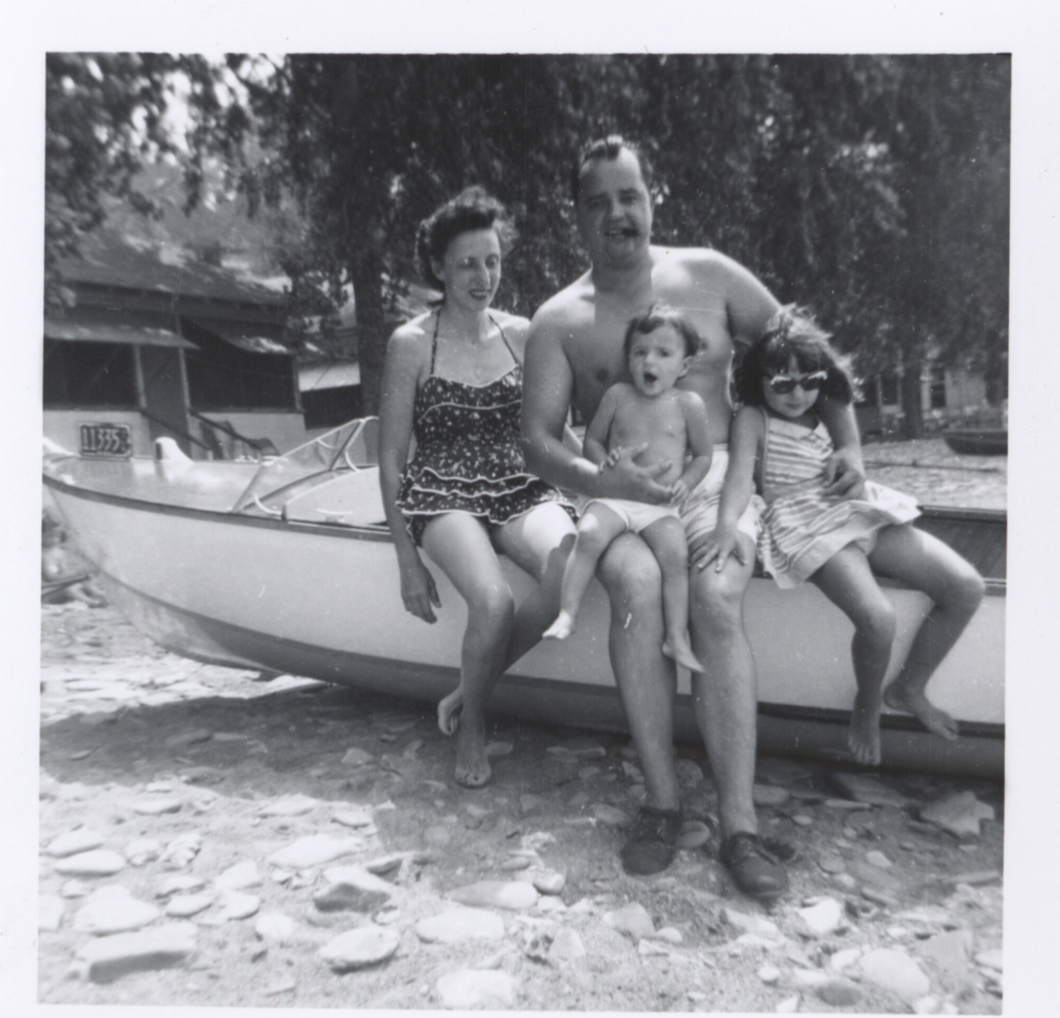 Ray and Louise Kins gather the kids for a picture with the boat, 1950s. Kins Family collection, MSS 20, Detre Library & Archives, Heinz History Center.