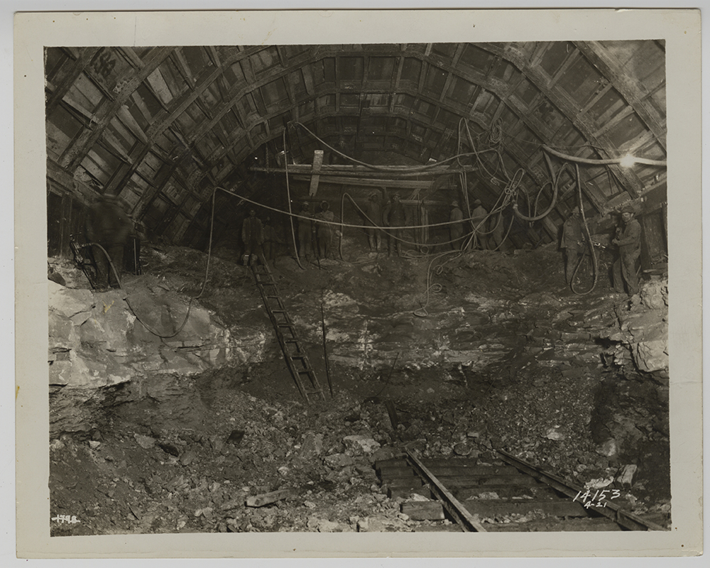 Crews drilling and clearing rock inside the Liberty tunnel shaft, 1920-1921. Heinz History Center.