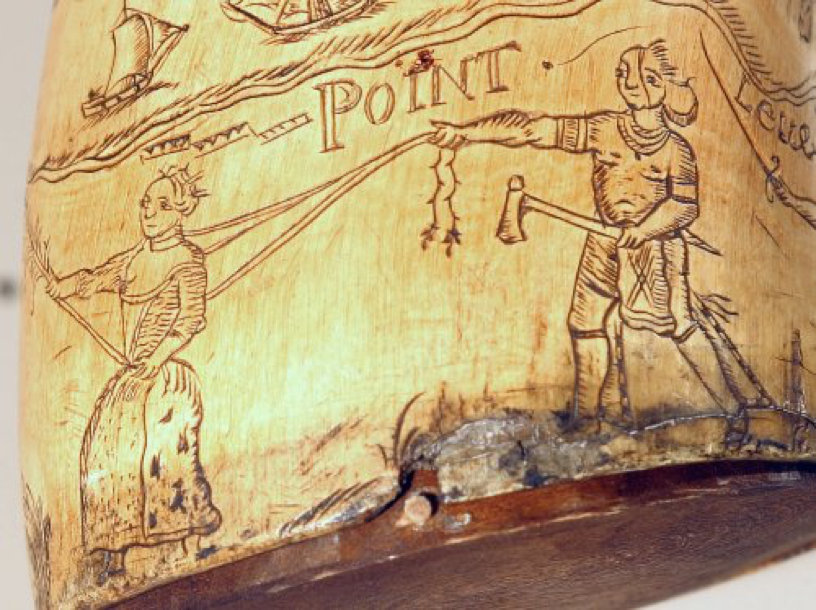 Detail of a powder horn on display in the Captured by Indians exhibition showing a female captive being led on a halter. Fort Pitt Museum, Pittsburgh, Pa.