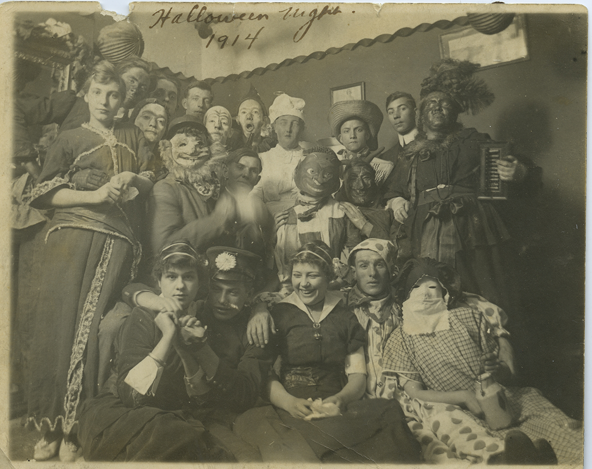 A festive group gathers for a Halloween Party in Millvale, 1914. Reiber-Sachs Collection, Detre Library & Archives at the Heinz History Center.