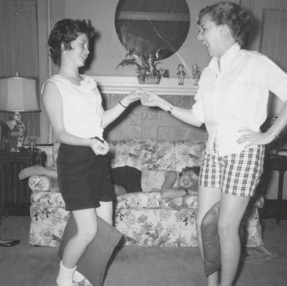 Susie Gordon and Barbara Taylor dance while Diane Taylor watches from the couch, 1958. Taylor Family Collection, Detre Library & Archives at the Heinz History Center.