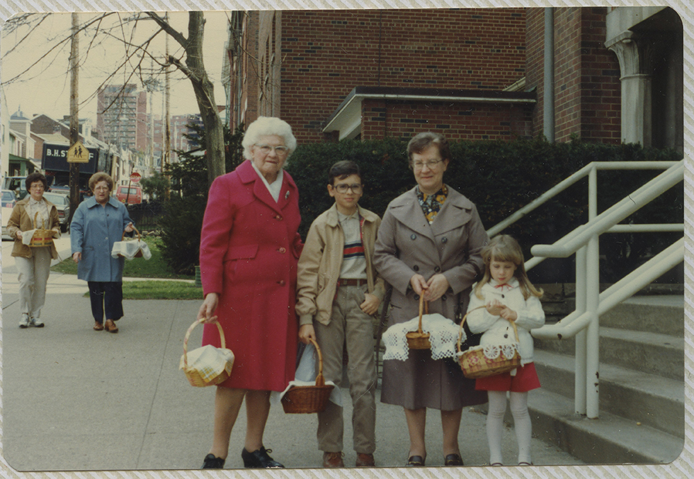 Group outside the Holy Family church in Lawrenceville for the Polish tradition of Święconka - the blessing of Easter foods on Holy Saturday. Heinz History Center.
