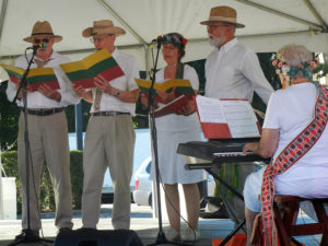 ALT:From left, Bill Kolicius, Albin Vareha, Anita DeChancie, Len Barcousky, and accompanist Nancy Binkney. All are members of Pittsburgh's Lithuanian choir, Bociai. 2016 Pittsburgh Folk Festival, which was part of the city's 200th anniversary celebration, Schenley Park. | Your #Pixburgh Photo Album | #Pixburgh: A Photographic Experience