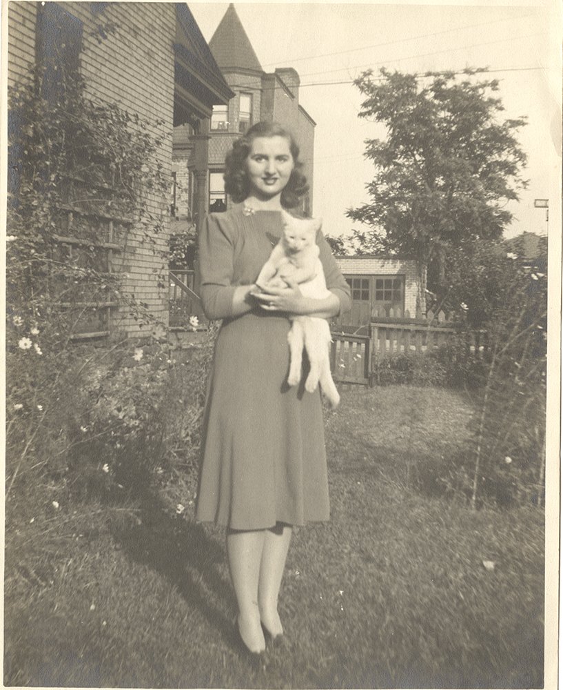 Anna Greenberg poses with her pet cat, c. 1940. Gift from the estate of Anna Greenberg. MSS 1010, Detre Library & Archives at the History Center.