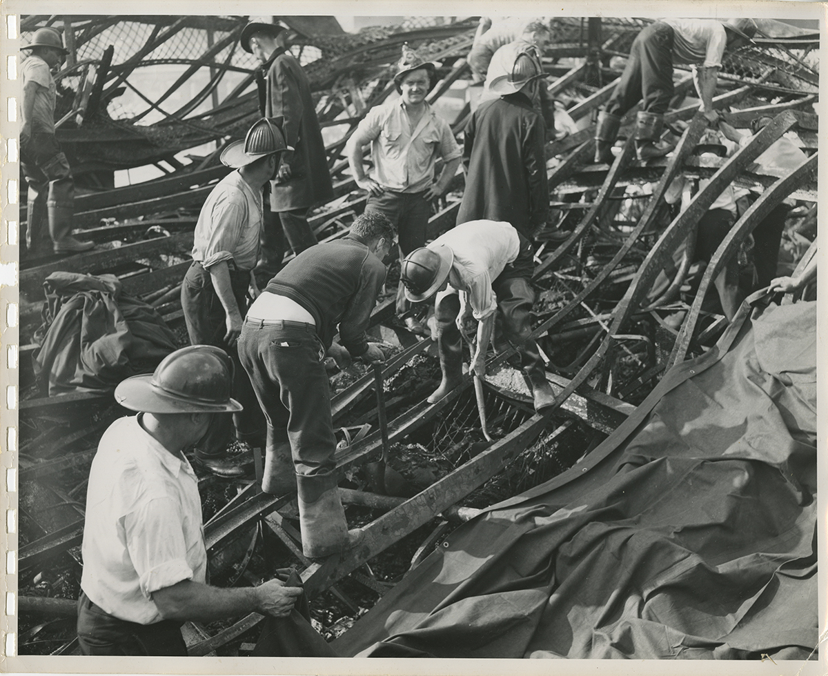 Investigators search through the collapsed steel remains of the Island Queen's five decks, 1947. | Heinz History Center