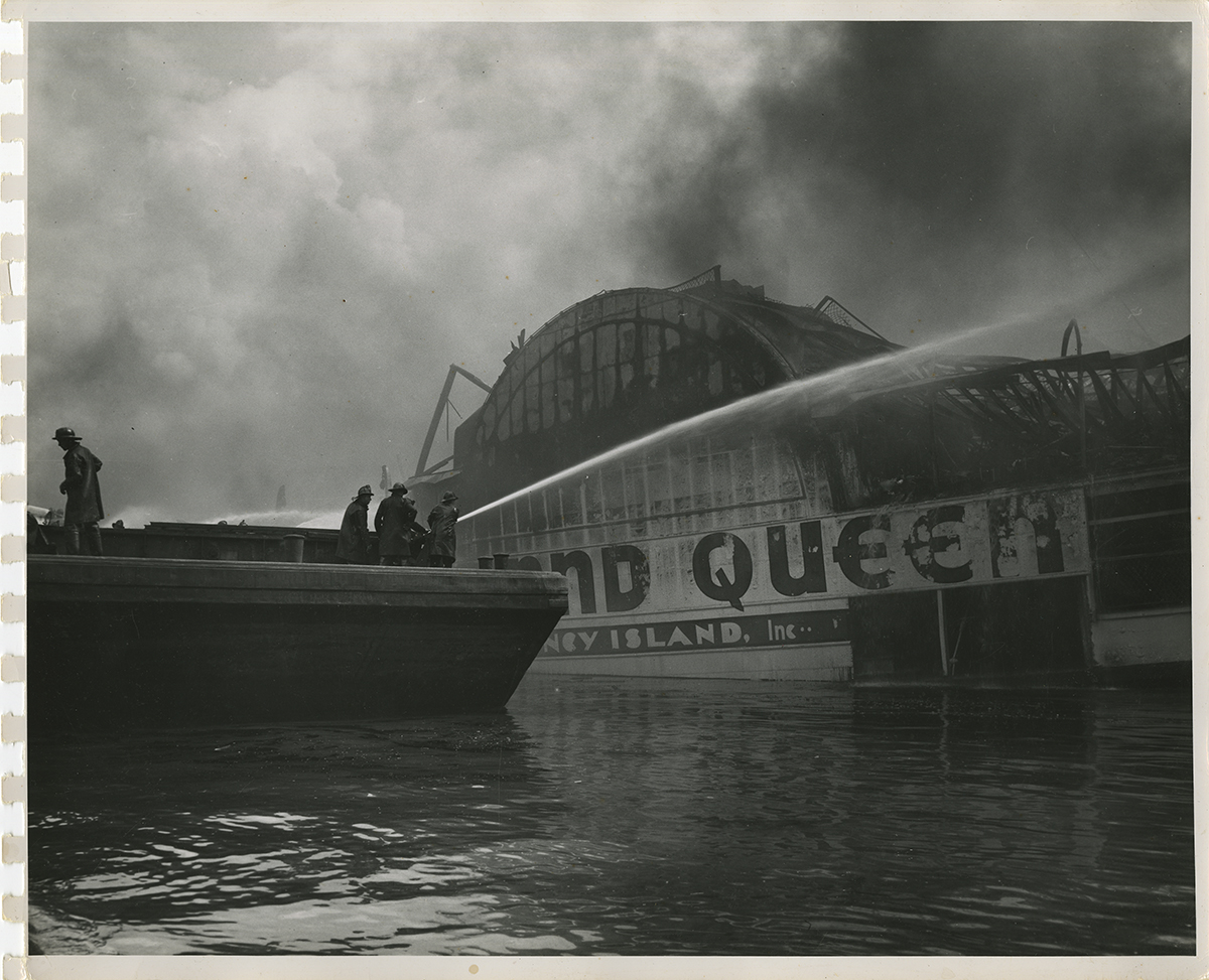 Fireman fight the flames as the Island Queen burns, 1947. | Heinz History Center