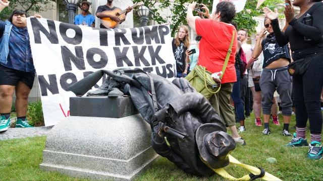 """The Confederate soldier monument was toppled at the courthouse in Durham as the crowd chanted """"we, we, we, are the revolution…the people united will never be defeated."""""""
