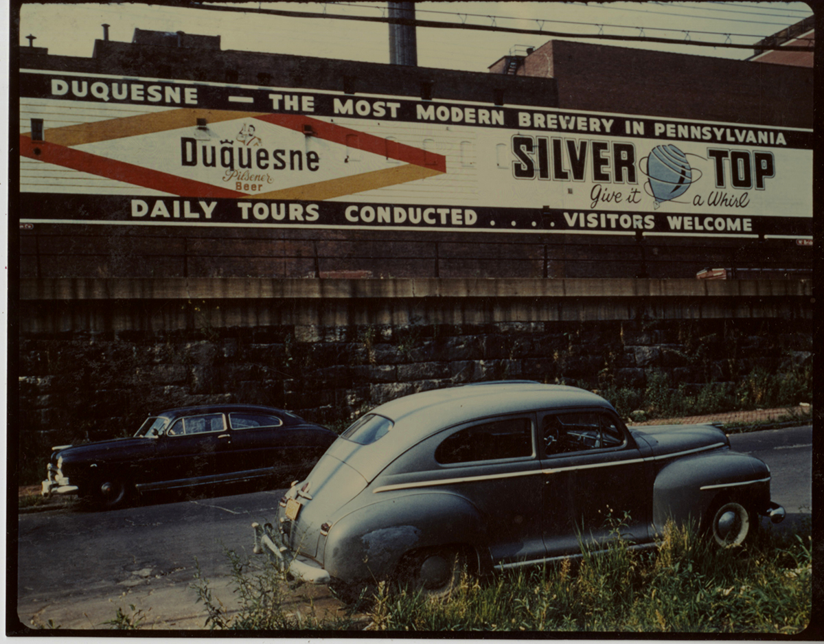 Wall sign in Pittsburgh advertising Duquesne Pilsener and Silver Top beer, 1940s. | Heinz History Center