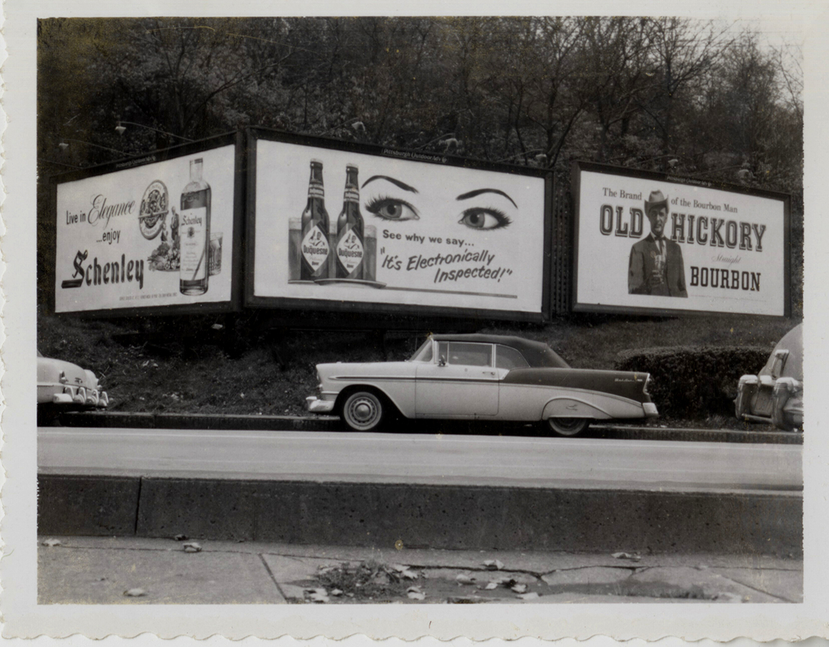 """""""It's Electronically Inspected!"""" Parking along a Duquesne Pilsener billboard, late 1950s. 
