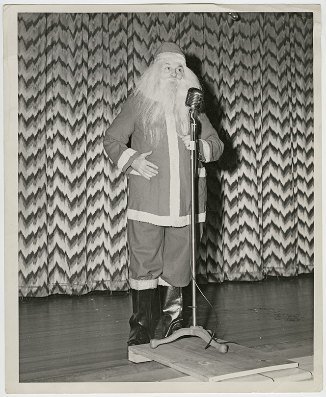 George Heid plays Santa on stage. Photo courtesy of Jim Heid.