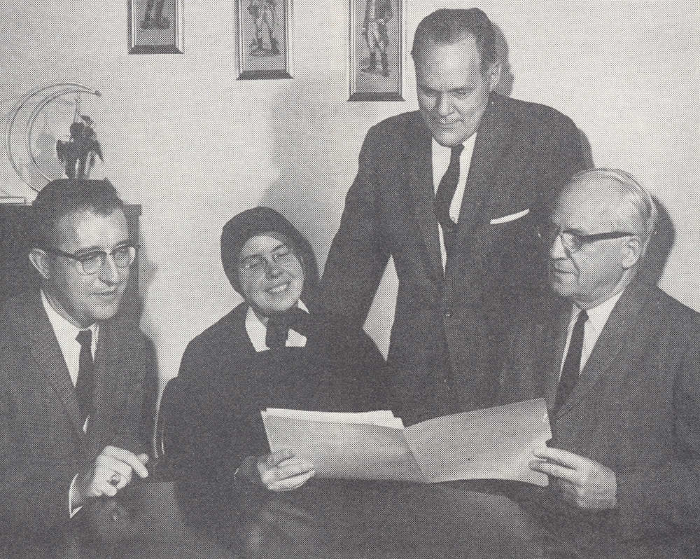 Evanson (on the right) confers with local educators while planning a high school choral performance for a meeting of the National Federation of Music Clubs. Jacob A. Evanson Papers, Detre Library & Archives at the Heinz History Center.