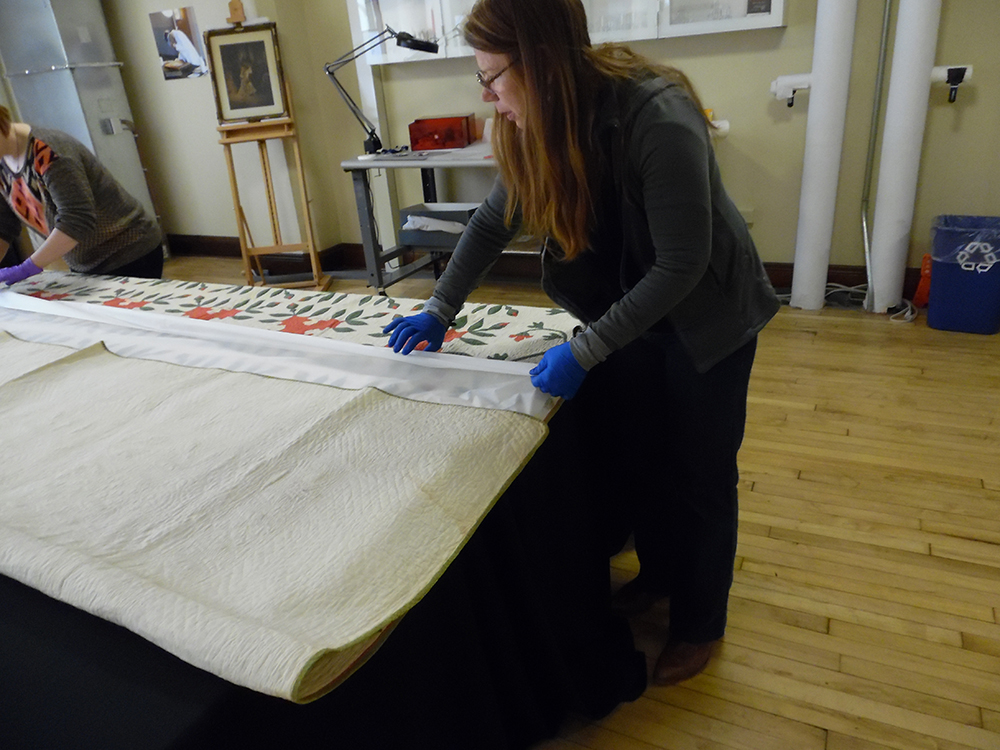 Acid-free tissue paper is inserted between quilt layers to help pad during folding.