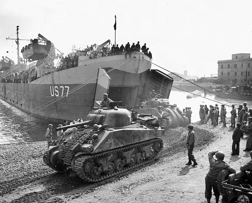Sherman tanks unloading from LST 77 at Anzio, Italy in May 1944.