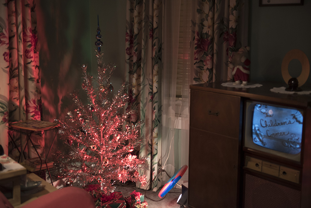 1950s suburban house all decked out for Christmas, including an aluminum Christmas tree, in the Pittsburgh: A Tradition of Innovation exhibit.