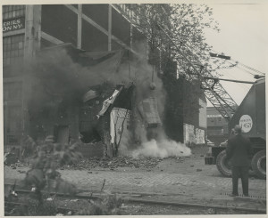 ALT:The first building at the Point being razed for the construction of Point State Park, May 5, 1950. Photograph by John R. Shrader. Allegheny Conference on Community Development Photographs, 1892-1981, MSP 285, Senator John Heinz History Center.
