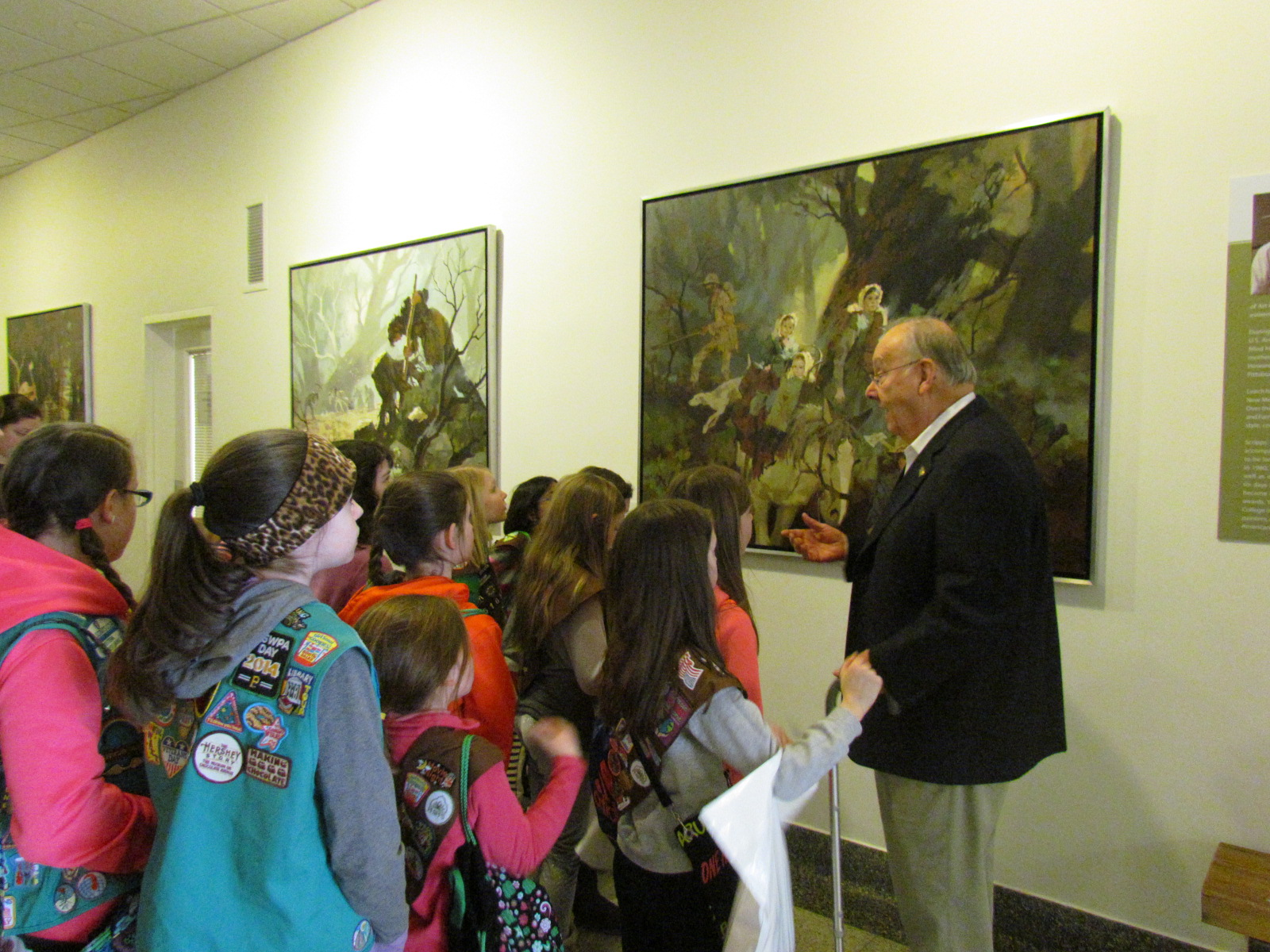 Jack Sheehan, History Center and Fort Pitt Museum docent, with a Girl Scout troop at the Fort Pitt Museum.