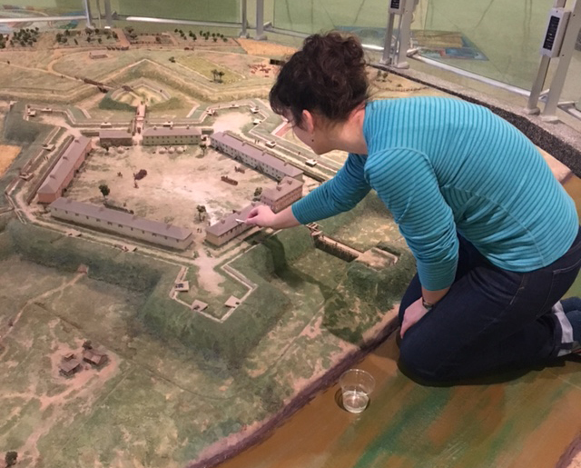 Jaclyn Sternick, a Fort Pitt Museum staff member, cleaning the Fort Pitt diorama.