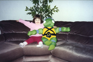 ALT:Liz Simpson with her Teenage Mutant Ninja Turtle plush, 1990. | I Had That! Childhood Toys Photo Gallery