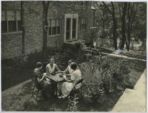 ALT:Four women playing cards in lawn at Chatham Village, 1932. | Buhl Foundation Photographs, MSP 187, Detre Library & Archives at the Senator John Heinz History Center.