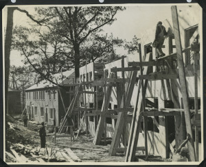 ALT:Construction workers building several Chatham Village housing units, October 1935. | Buhl Foundation Photographs, MSP 187, Detre Library & Archives at the Senator John Heinz History Center.