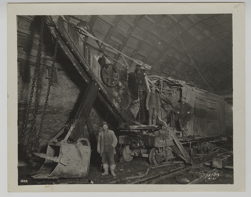 Workmen pose with their Marion steam shovel inside the Liberty tunnel, 1920-21. Heinz History Center.