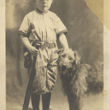 James Cox Barrett poses in his baseball uniform with his faithful dog, 1920s. | pixburgh: a photographic experience, Heinz History Center