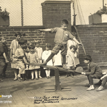 Balancing on the seesaw at the Irene Kaufmann Settlement playground, Hill District, 1924. | pixburgh: a photographic experience, Heinz History Center