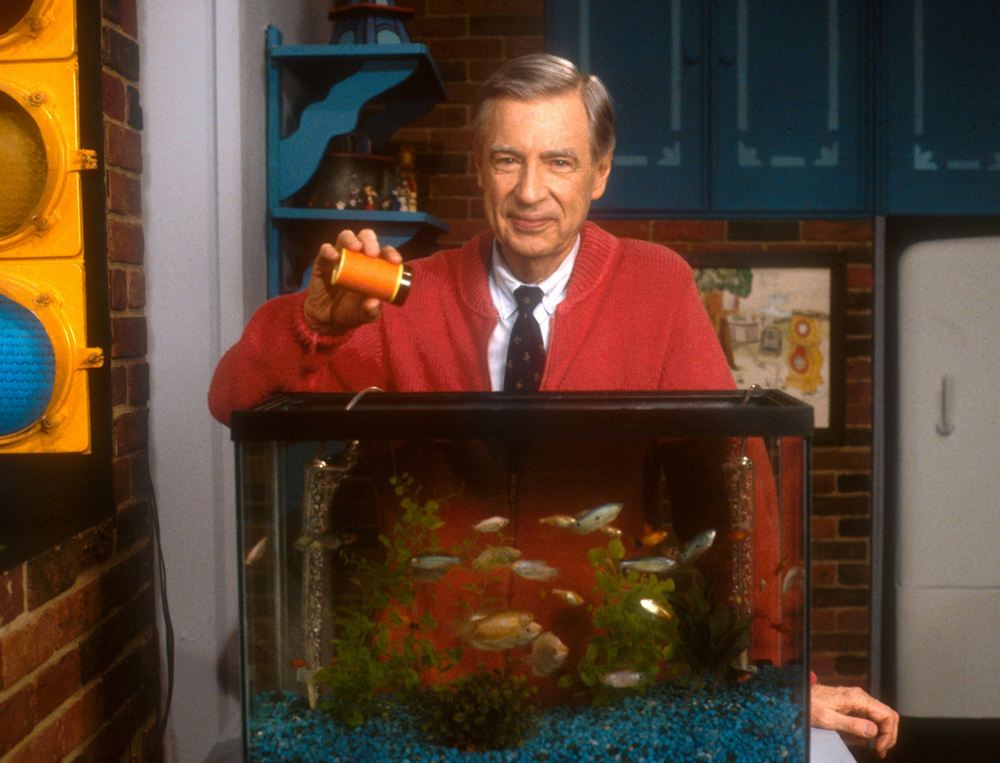 "Mister Rogers feeding the fish during ""Mister Rogers' Neighborhood."" Photo courtesy of The Fred Rogers Company."