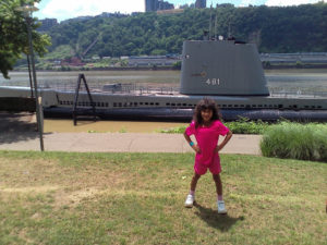 ALT:Katie (8), June 2016, in front of the U.S.S. Requin, in the Ohio River outside the Carnegie Science Center. | Your #Pixburgh Photo Album | #Pixburgh: A Photographic Experience