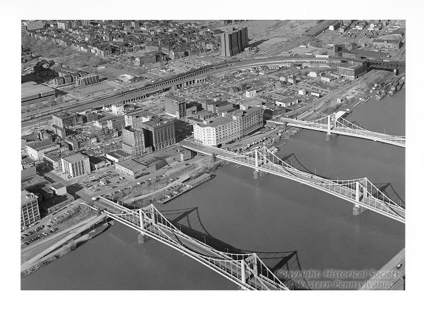 "Aerial view of the North Side, featuring Pittsburgh's ""Three Sister"" Bridges, the Sixth, Seventh, and Ninth Street Bridges, Allegheny Conference on Community Development Photographs, Detre Library & Archives at the History Center"