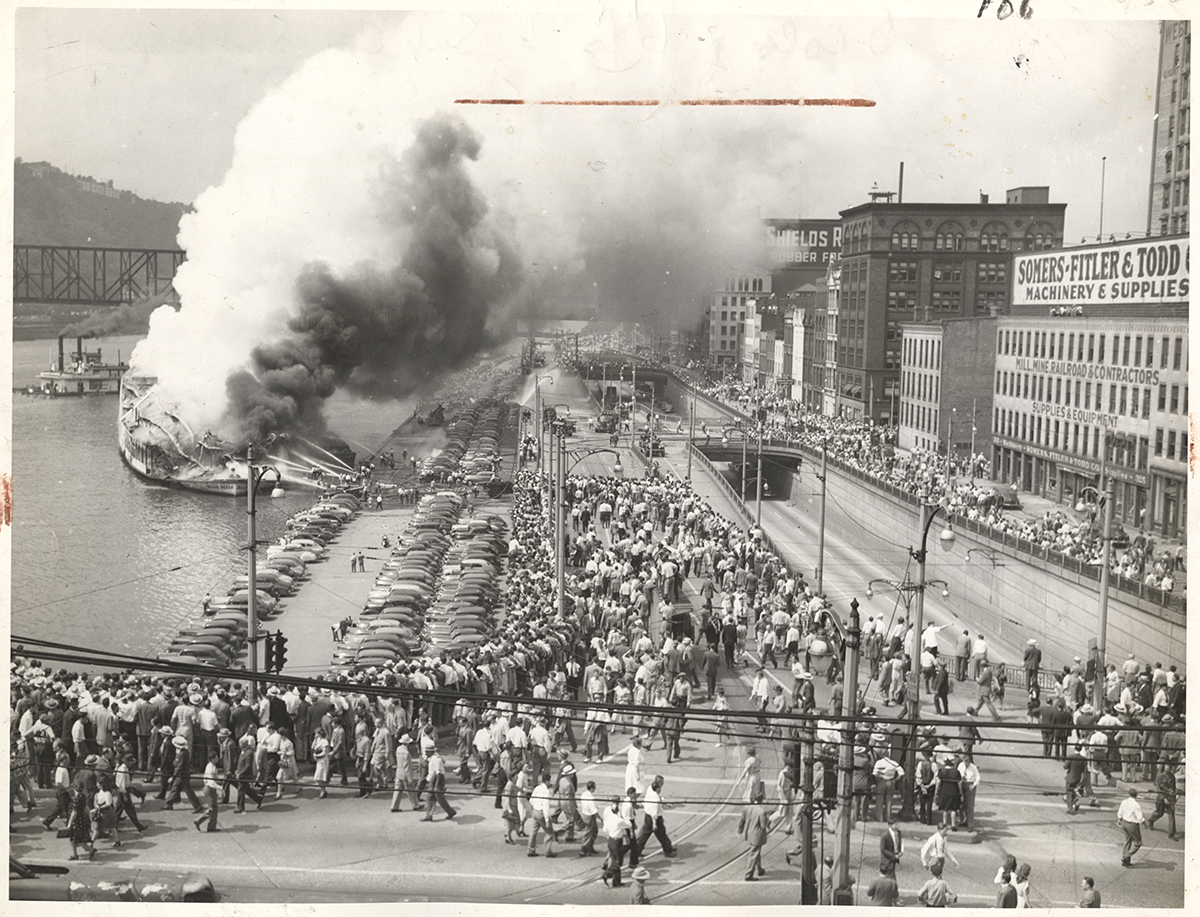 The explosion of the Island Queen brought crowds of people to the Monongahela wharf, 1947. | Heinz History Center