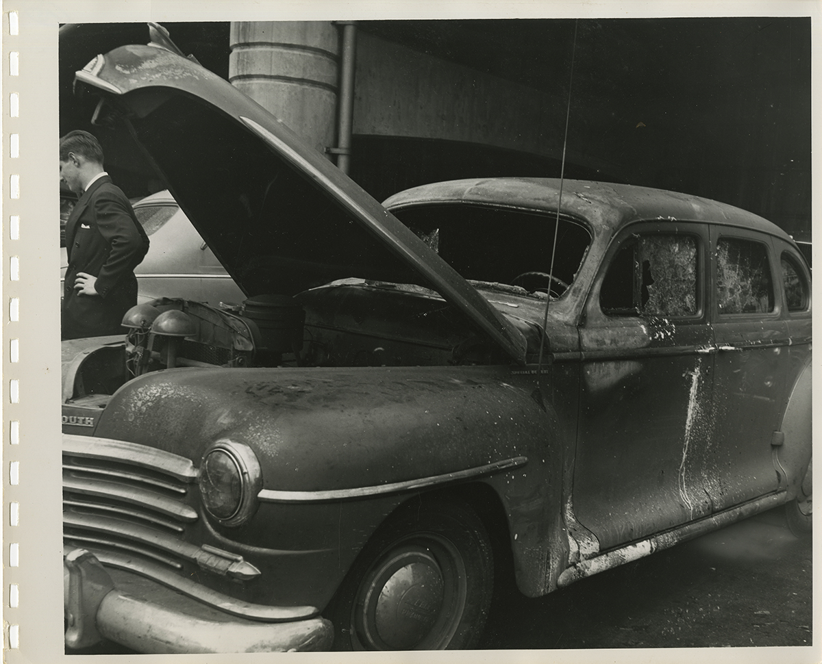 A damaged car shows the aftermath of the explosion's impact on vehicles parked on the Mon wharf, 1947. | Heinz History Center