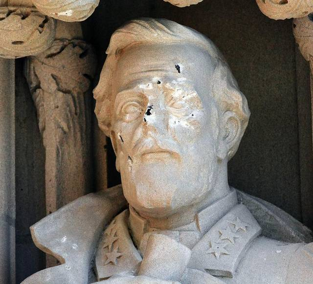 The Robert E. Lee statue at Duke University was defaced before being removed from its chapel niche.