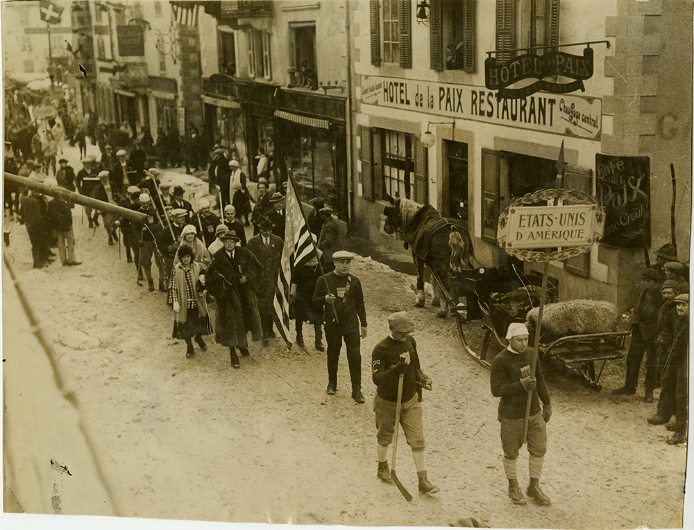 The U.S. team parades through Chamonix, France in the opening ceremonies. Herb Drury leads his team carrying the banner, 1924. Courtesy of Frederick R. Favo.