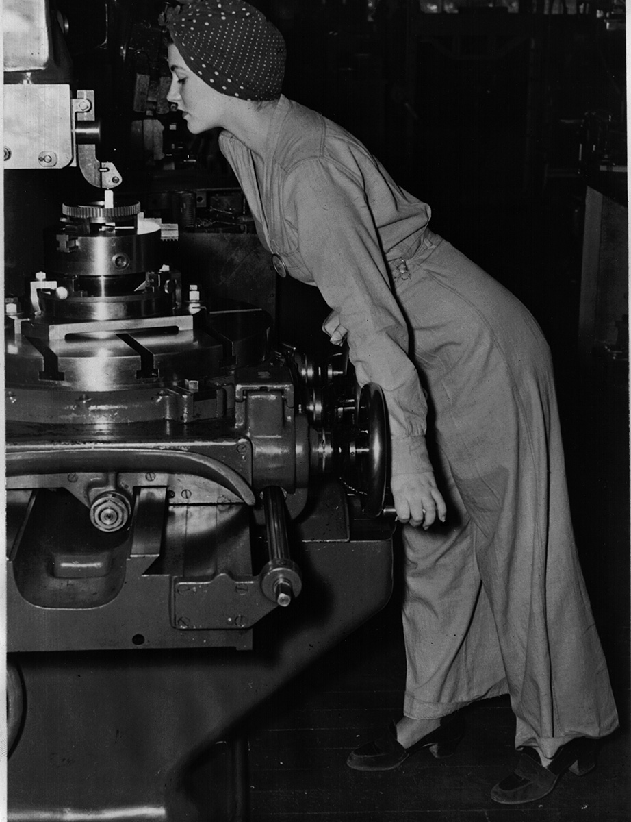 20-year-old Naomi Parker [Fraley], working at the Naval Air Station in Alameda, Calif.