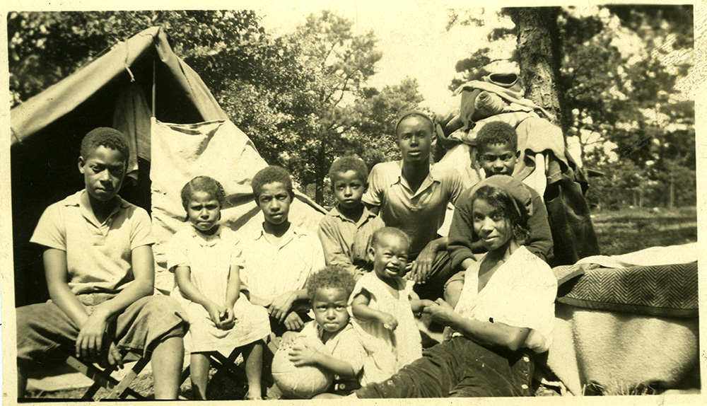Dorsey captured this photo of his wife Zerbie and eight of their stair-step children on a camping trip to the forest at Sidling Hill in 1932.